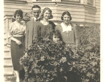 "Vintage Photo ""Hiding In The Bushes"" Pretty Girl Only Her Head Is Visible In Group Photo Found Vernacular Photo"