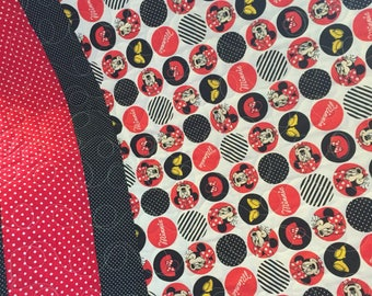 Minnie Mouse print in all cotton.the backing is a white cotton, and Machine quilted by me. An heirloom qualit