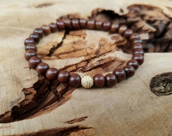 Stackable 6mm Wood Stretch Bracelet With A Gold Micro Pave CZ Bead