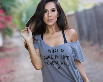 What is Done in Love is Done Well. Off the Shoulder Flutter Sleeve Muscle Tee. Made in the USA. Off the Shoulder Lounge Tee. Love Shirt.