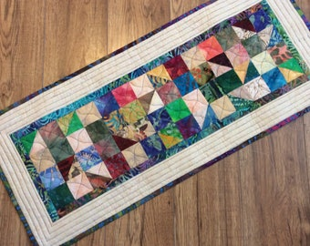 Scrappy Quilted batik table runner in multi colours, reversible backing in blues, greens and multi colours, Coffee table runner