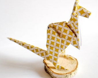 Kangaroo origami on wooden base
