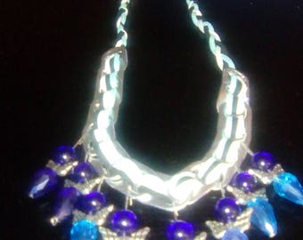 Jewellery made with cans of soft drinks and sunflower seeds