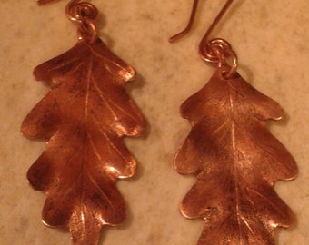 Handmade copper earrings with oak leaves in ancient Celtic style