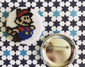 "2.25"" pinback cross stitch button - tanooki mario"