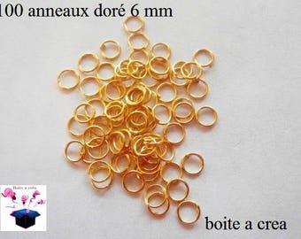100 6 mm, gold simple open hoops.