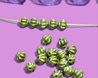 bronze 20 small pumpkins 06mm colored beads