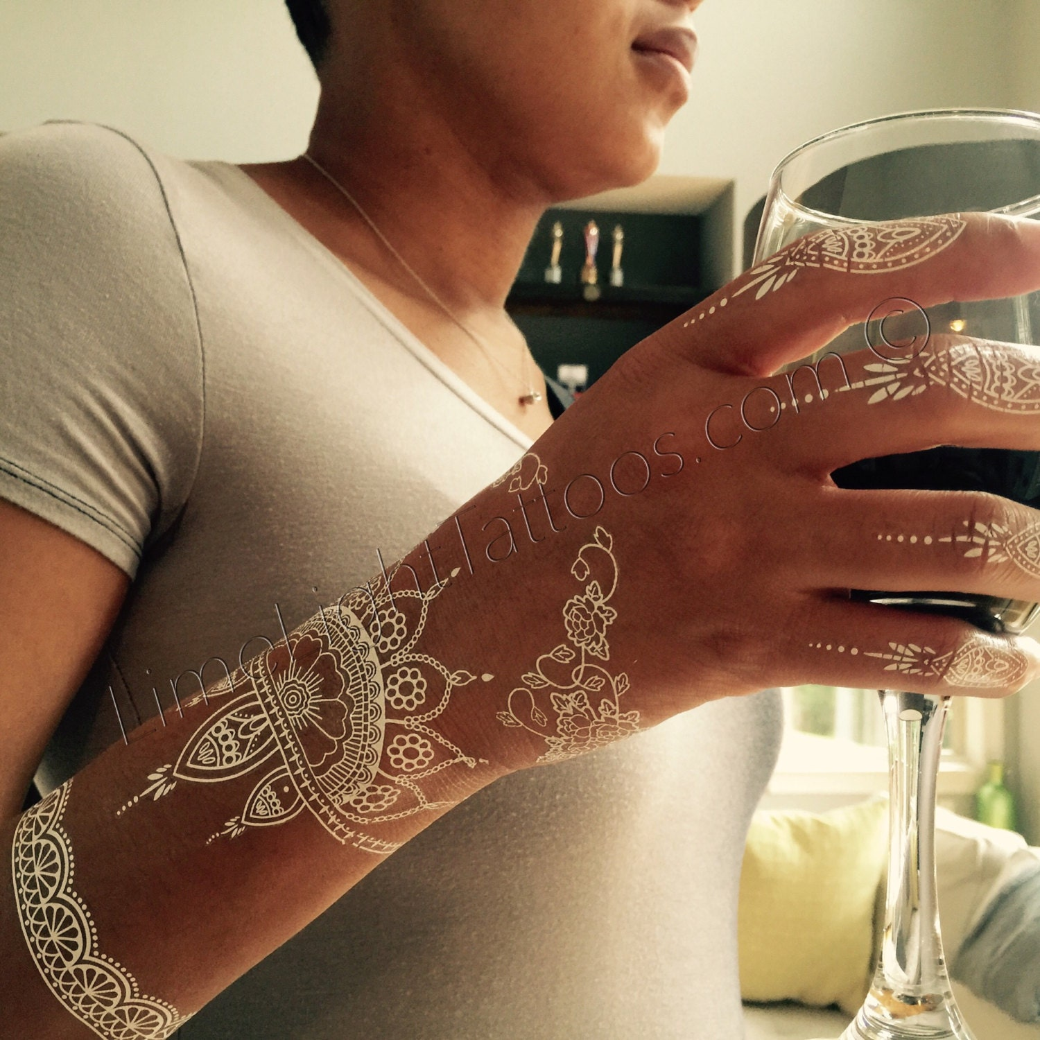 White Mehndi Tattoo : Sheet of white henna tattoos lace