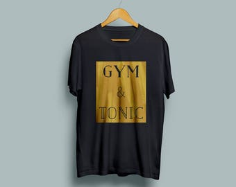 Gym and Tonic Gold Unisex T-shirt in Black, Grey or White.