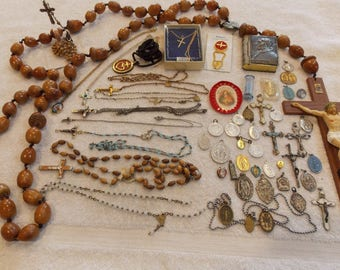 Lot 54 piece religious theme many rosaries, necklace crosses, religious charms/pendants, huge rosary to tiny