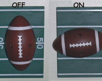 football light switch cover with rotating football