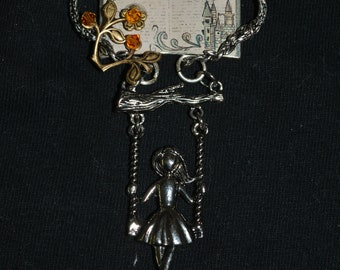 Fairy tale necklace Once upon a time girl in a swing flowers 24 in chain