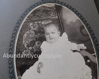 baby in very fancy white gown, vintage cabinet card photo, ornate antique chair, vintage photography, black and white