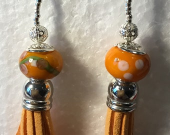 Orange suede Tassel and lampwork bead earings