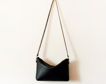 Black leather crossbody bag with zipper