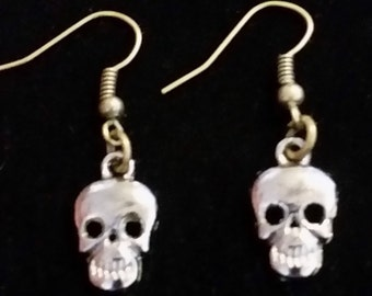 Awesome reflective silver colored skull charm dangle earrings