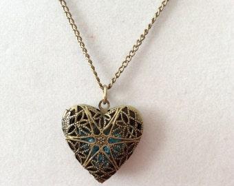 Detailed Antiqued Heart Locket Filled With Blue Beads, filigree locket, bronze locket, picutre locket, heart locket