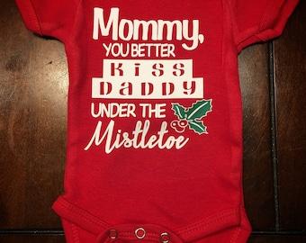 Mommy kissing Daddy under the Mistletoe