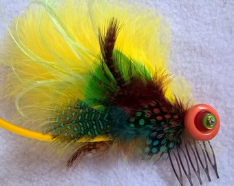 fluorescent feather comb