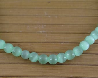 60 round 6 mm clear pvc097 green cat's eye glass beads