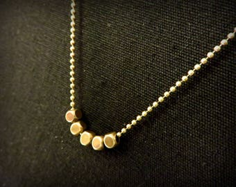Necklace five cubical faceted brass beads