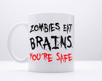Zombie Coffee Mug: Zombies Eat Brains You're Safe Funny Quote Humour Walking Dead Style
