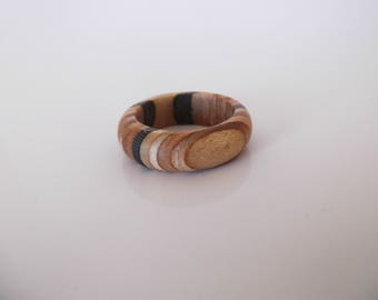Rings made from recycled skateboards ( stripped slim)