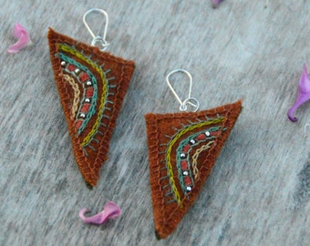 Hand embroidered rustic orange textile earrings. Earrings with embroidery and silver color nickel free beads.
