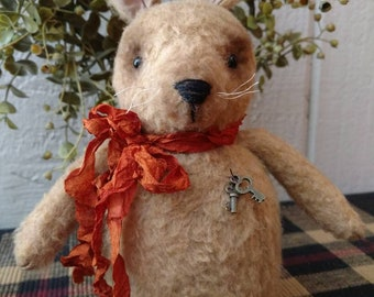 Beans, our primitive fuzzy rabbit wearing hand dyed silk ribbon and a set of keys
