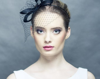 Black fascinator with openwork petals and veiling, black veiling with modern decoration, fascinator with netting