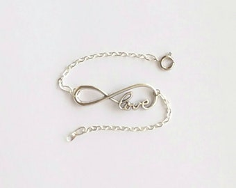 Beautiful sterling silver bracelet that goes great with everything that has a cursive love infinity sign.