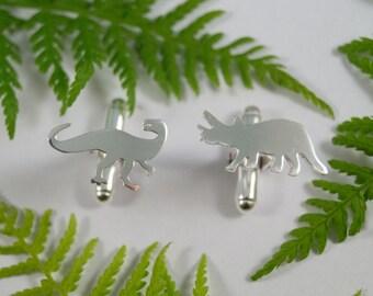 Silver Dinosaur cufflinks: A pair of Dryptosaurus and Triceratops shaped sterling silver cufflinks.