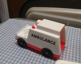 Fisher Price vehicle set-4 pieces, ambulance, fuel tanker, mail trucks