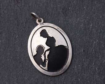 Silver silhouette victorian couple pendant. Sterling silver
