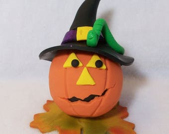 Pumpkin wearing witch hat with a green worm: Polymer clay Halloween and Fall decorations