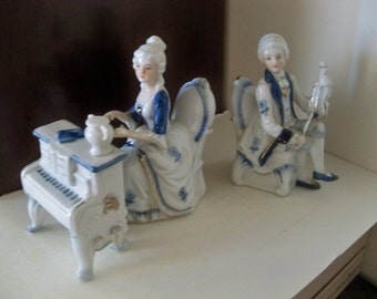 mr and mrs fancy high society musicians figurines