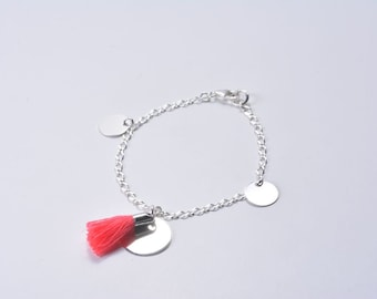 Thin silver bracelet, medals and coral tassel