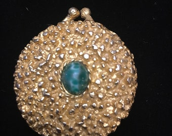 Vintage 1950s gold tone metal compact with faux turquoise gemstone on top