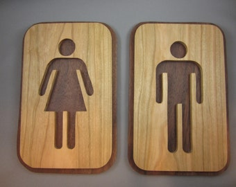 A Pair of His and Hers Bathroom Signs
