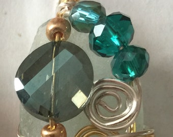 Small aqua sea glass all wrapped up in gold and silver with a touch of glitz