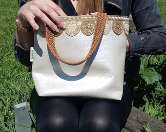 Pink gold cream handbag