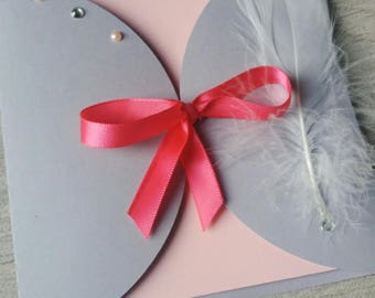 share gray and pink. decorative feathers