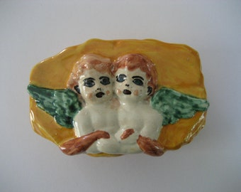 vintage handmade folk art ceramic box  with two cherubs        on the lid