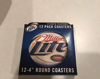 Four round coasters in original box