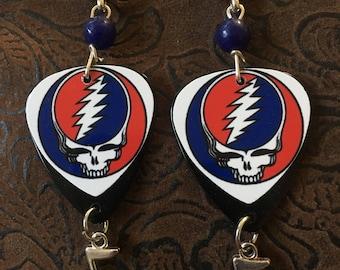 Grateful Dead logo guitar pick earrings.