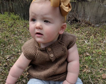 Knit baby dress and cardigan