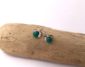 New improved waterproof design! Itty bitty, rainforest green eco-resin studs on allergy-friendly surgical steel.
