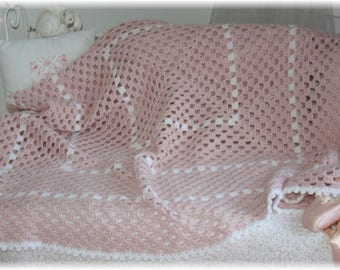 Pretty pink powder and white crocheted blanket