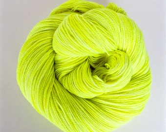 VOLT yellow hand dyed yarn fingering sock dk bulky yarn super wash merino wool yarn single or ply. you choose your base. neon yellow yarn