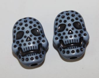 Skull double-sided, blue, 15 * 20 mm, the pair
